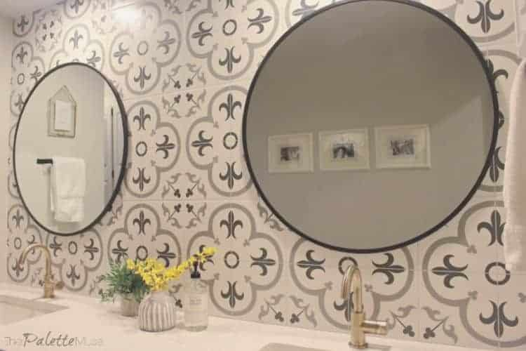 Patterned tile backsplash wall with round mirrors