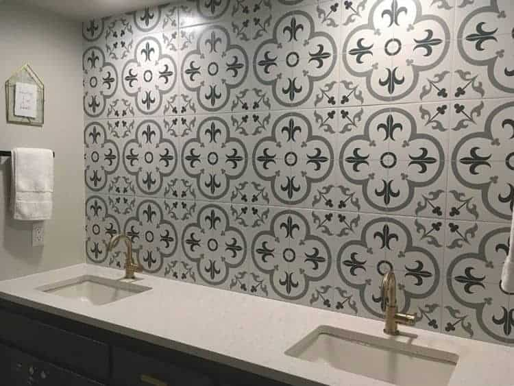 Patterned tile wall backsplash over double sinks