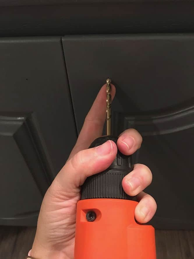 Drilling hole for cabinet hardware installation