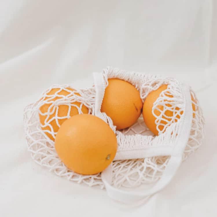 Oranges in shopping bag