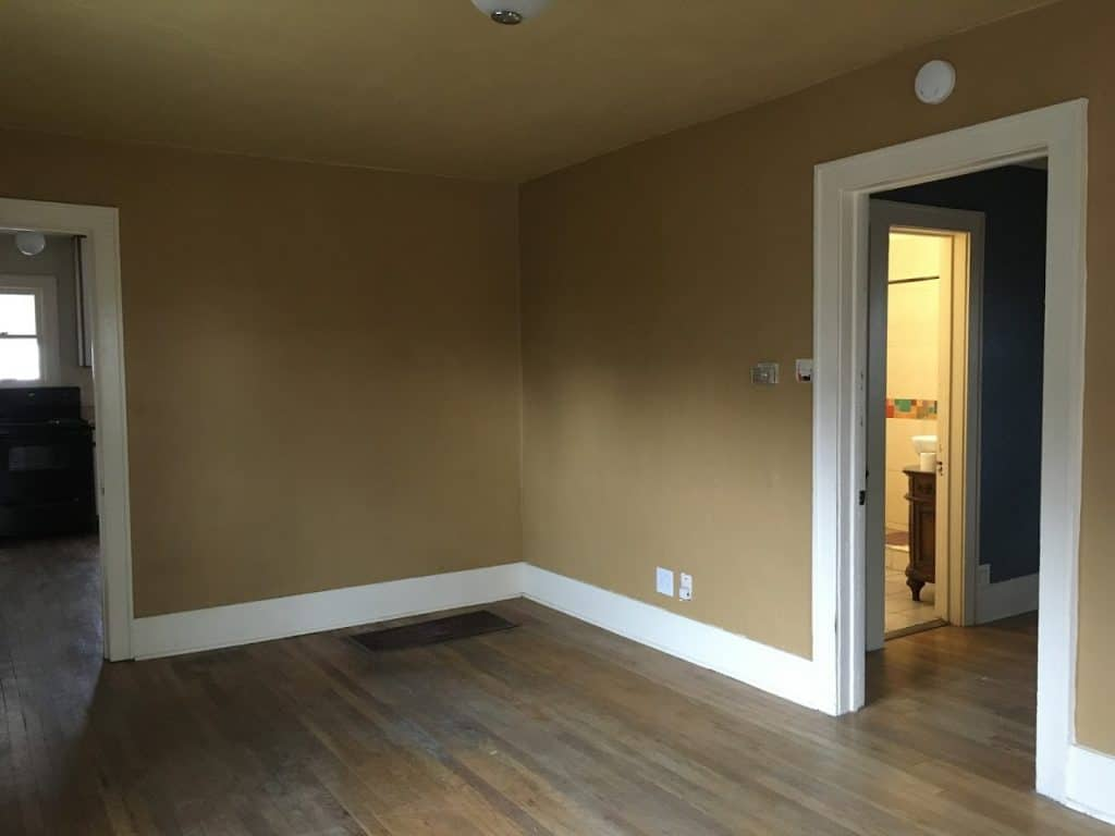 Brown wall and ceiling paint makes a small living room look even smaller.