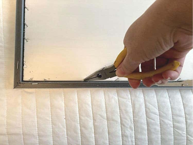 pulling the staples out of a framed print