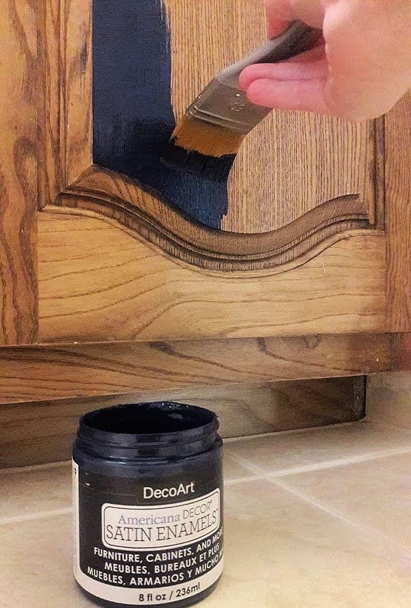 Painting wood cabinet with dark blue DecoArt Satin Enamel paint