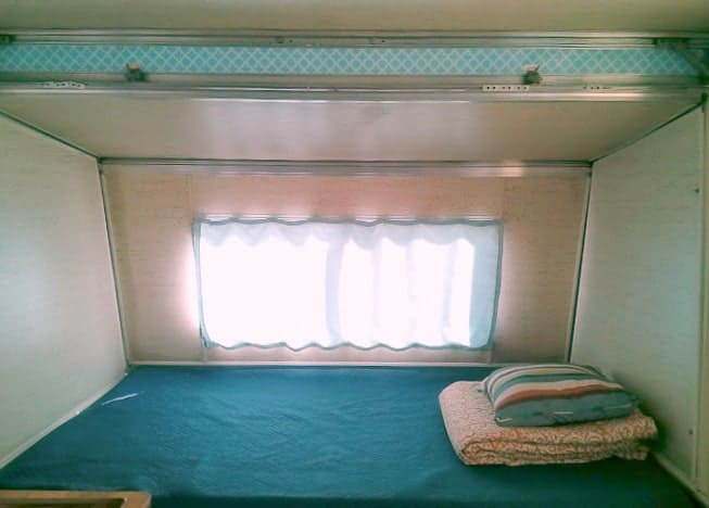 Blue bedding in Apache Camper