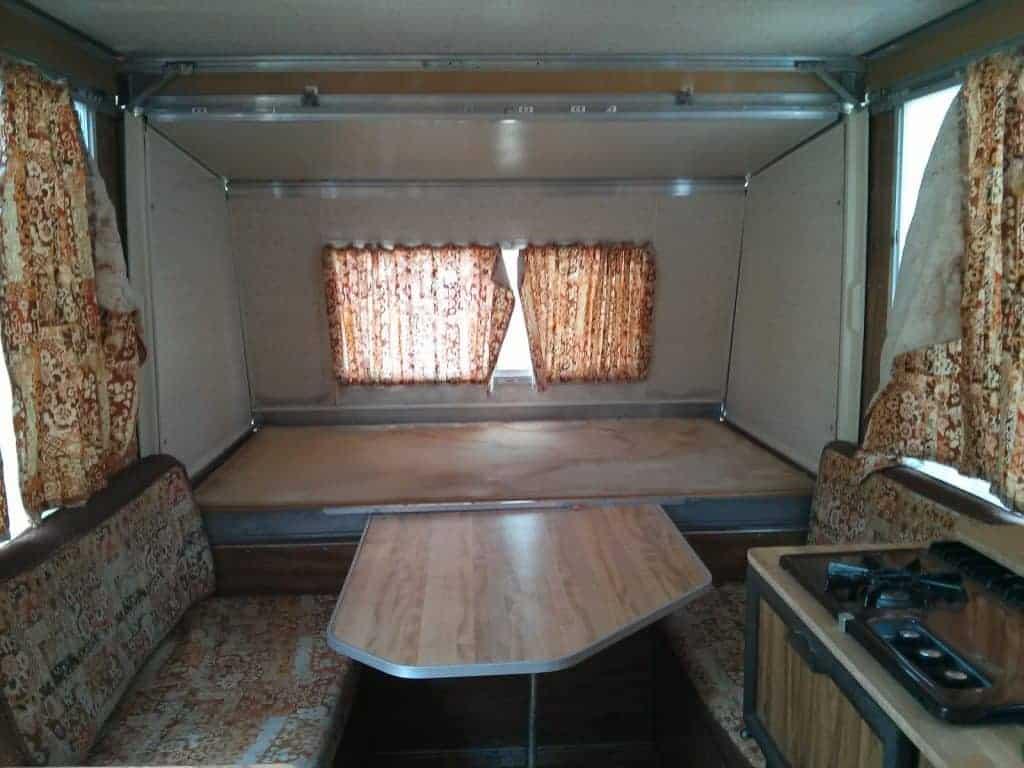 Apache Camper interior with original brown curtains