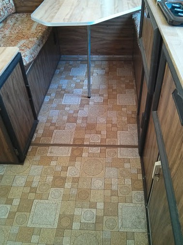 Brown and yellow patterned linoleum flooring in Apache camper