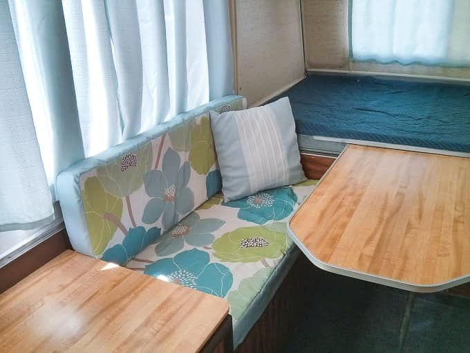 Camper dining space with blue cushions