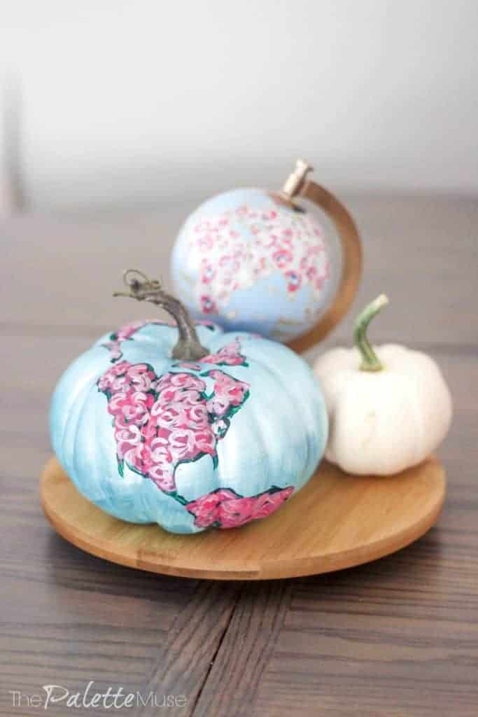 Floral map painted pumpkin as table centerpiece