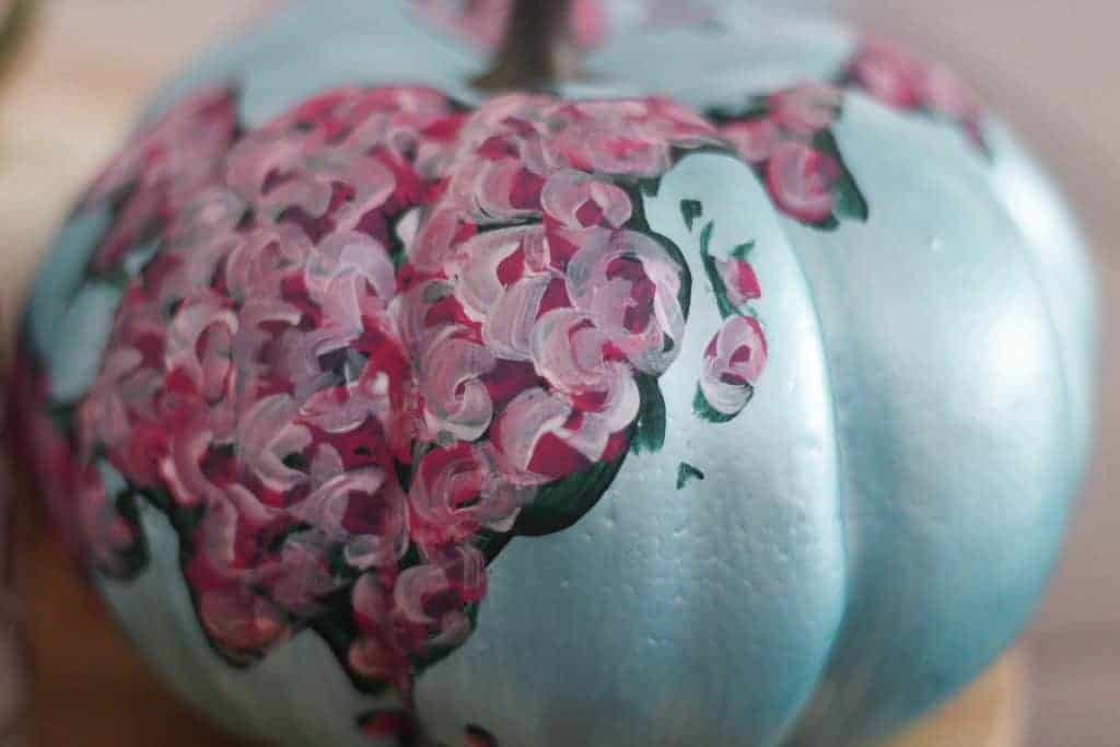 Detail of painted pumpkin with swirly flowers
