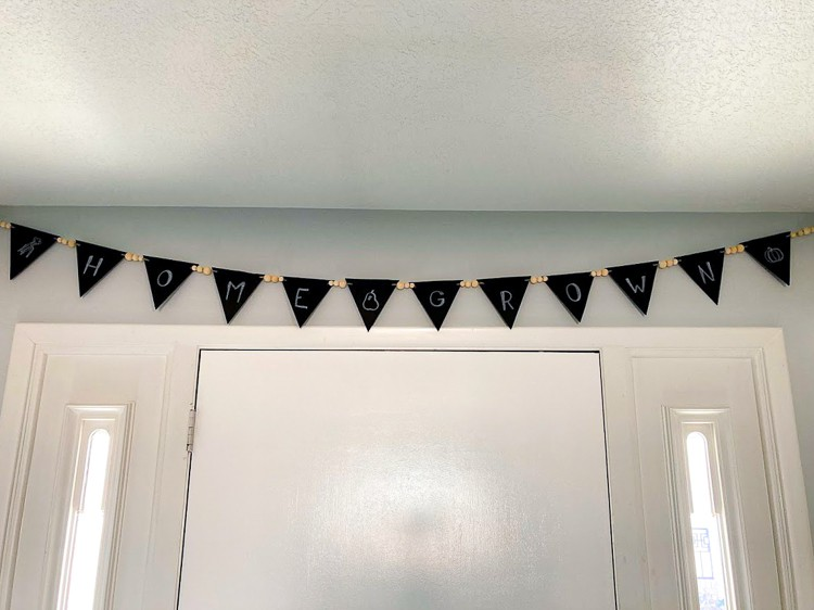 Chalkboard banner hanging over door