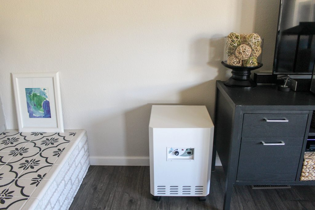 The EnviroKlenz air purifier sits in a corner cleaning your air without having to think about it.