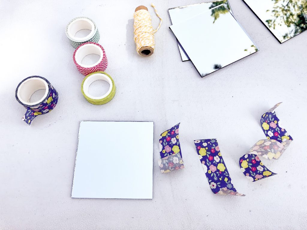 Mirrors and washi tape collected to make a DIY flower press