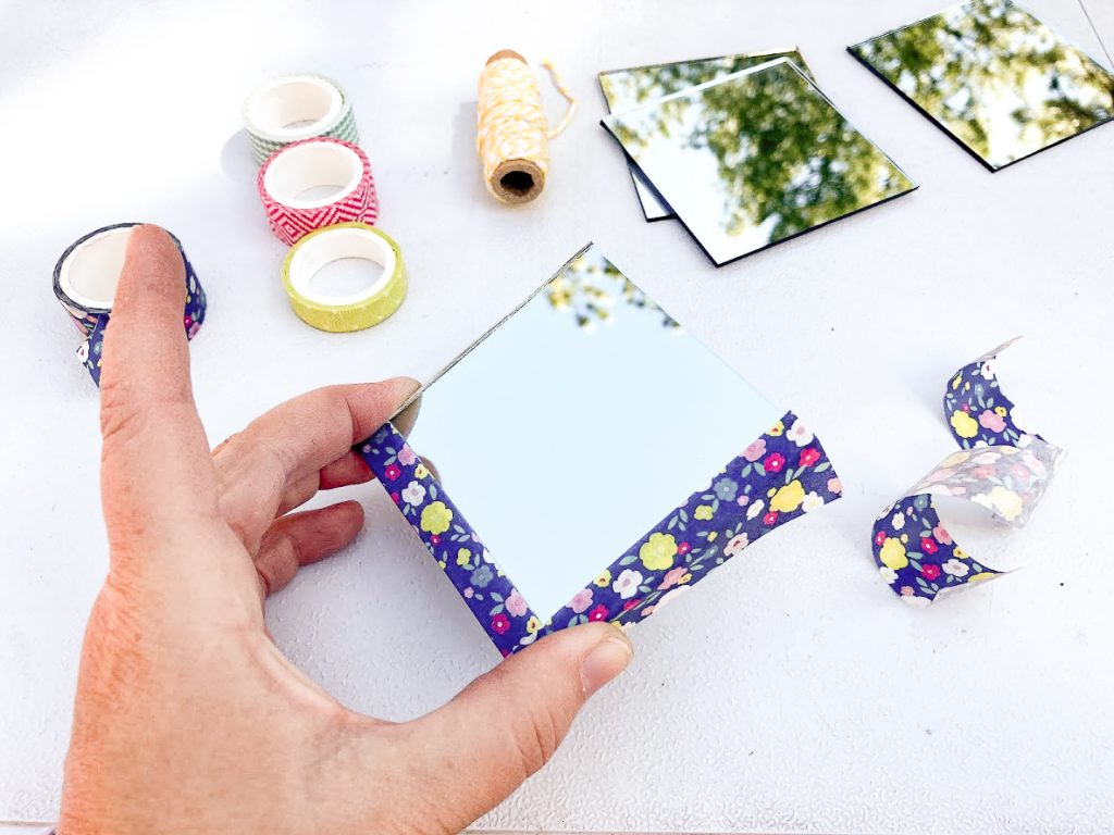 Adding washi tape to mirror for mini flower press