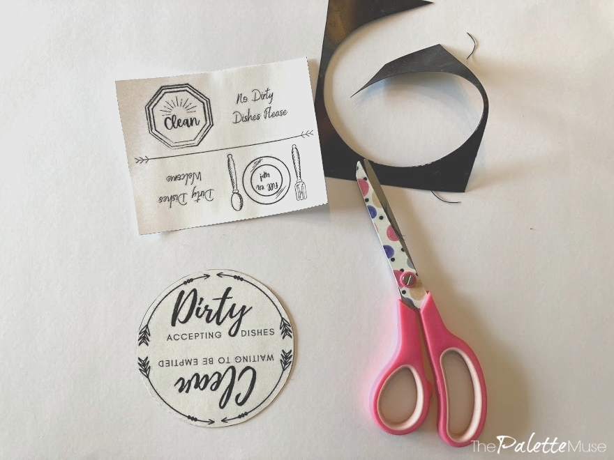 Making a dishwasher magnet with a printable, scissors, and a magnet sheet.