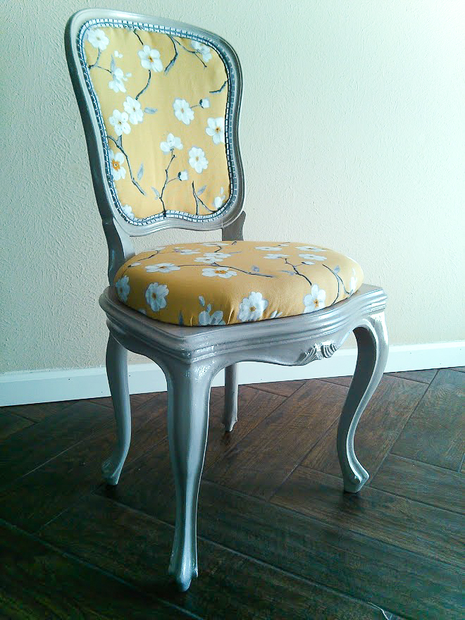 Gray paint and yellow upholstery fabric gave this chair new life
