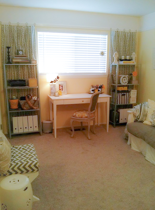 Sunny home office and guest room with yellow and gray decor.