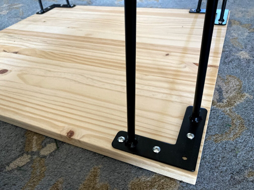 Screws attaching hairpin legs to the dog crate side table