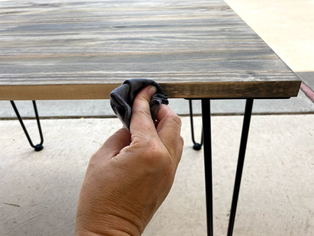 Applying gray stain to the dog crate side table