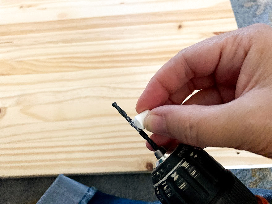 Marking drill bit with chalk so you don't drill completely through the wood
