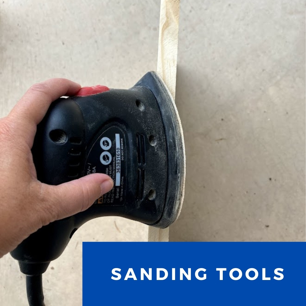 Sanding Tools showing a hand holding a detail sander to a piece of wood